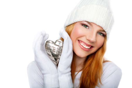 Smiling girl holding valentine heart  isolated on white background Stock Photo