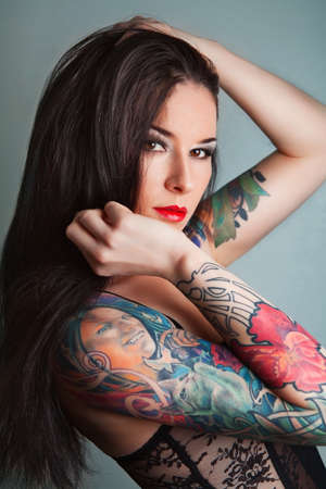 nude art model: pretty young girl with tattoo. lovely woman. Stock Photo
