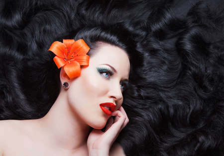 Young beautiful brunette  girl with flowers in her hair.