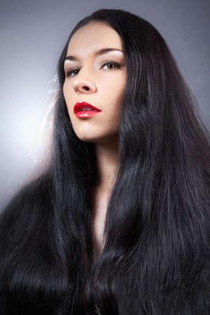 Beautiful Brunette Girl. Healthy Long Hair. Beautiful fashion hairstyle.