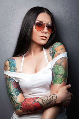 Beautiful sexy glamorous girl with tattoos.tattoo photo