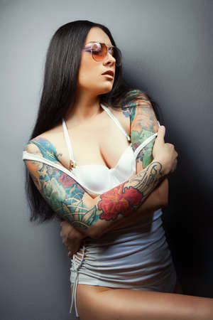 Beautiful sexy glamorous girl with tattoos. tattoos.