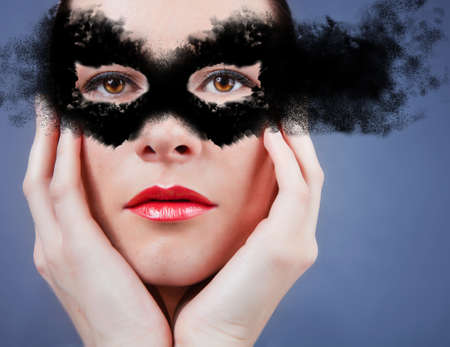 Beautiful young woman in mask. mask Stock Photo