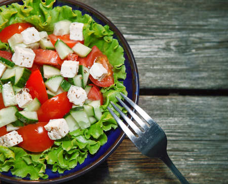 fresh salad with tomato and cucumber  green salad, tomato Stock Photo