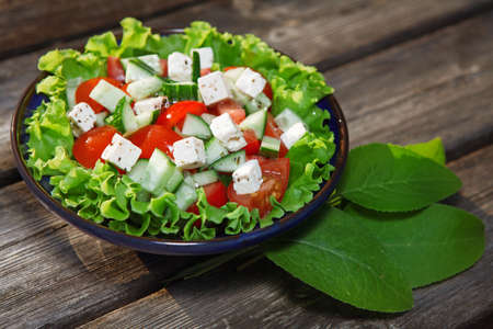 fresh salad with tomato and cucumber  green