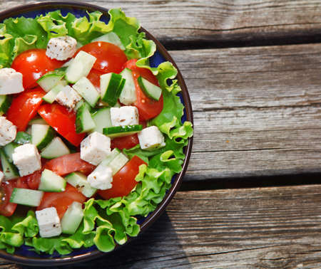 fresh salad with tomato and cucumber green Stock Photo