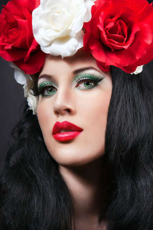 Close-up portrait of pretty young girl with roses  red roses photo
