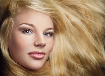 Close-up shot of young beautiful girl with long blond hair and stylish make-up Stock Photo - 16334029