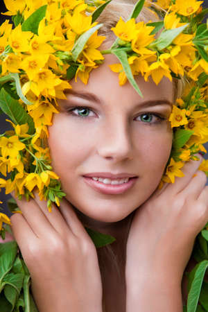 Close-up shot of young beautiful girl with flowers