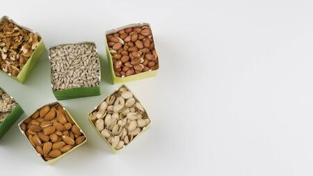 Eco-friendly packing. Paper bags with pistachios, sunflower seeds, walnuts, cashew, peanut ,almond, pine nuts . zero waste shopping sustainable living plasticfree. Top view. Flat lay