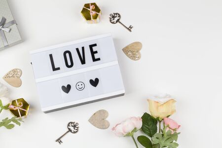 light box with text LOVE, decoration, gift and flower. love confession, happy valentines day, greeting card, copy space for text concept. top view close up flat lay 版權商用圖片