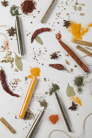 colorful composition with different spices and herbs in medical test tube. top view flat lay