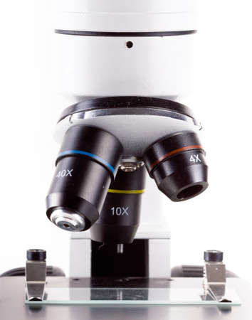 Microscope isolated on white photo