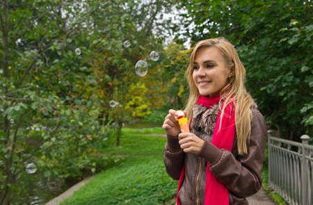 Woman blowing soap bubbles Stock Photo - 15693325