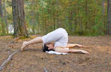 plough: Woman in yoga plough pose