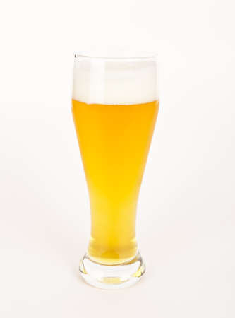 unfiltered: A glass of unfiltered beer on white