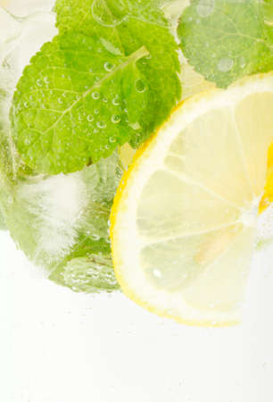 Healthy club soda with lemon and mint on white Stock Photo