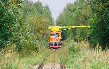 logging railroads: Special train crane carriage in forest with workers Stock Photo
