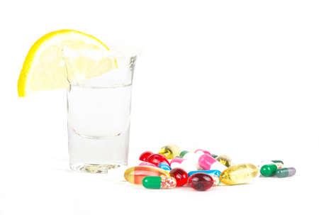 alcohol and tablets on white photo