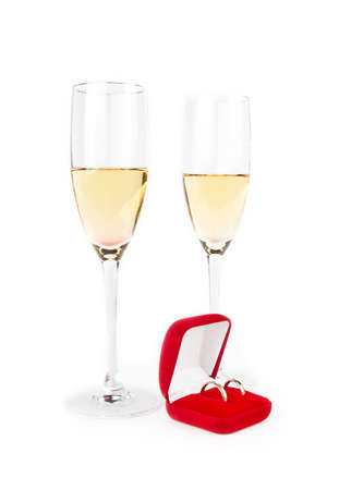 Two Valentine s champagne glasses with jewelery on white background Stock Photo - 17197307