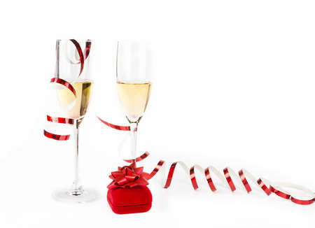 Two Valentine s champagne glasses with jewelery on white background Stock Photo - 17197313