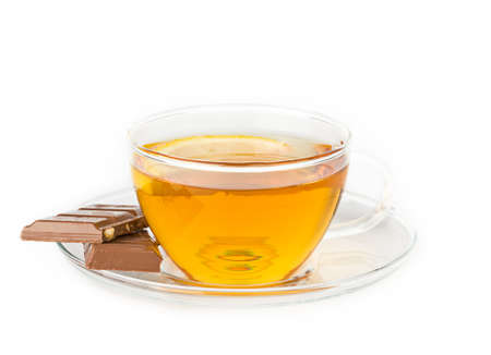 A cup of hot tea on white background photo