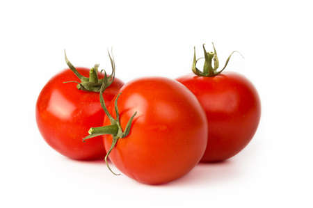 Tomato vegetables on white background photo
