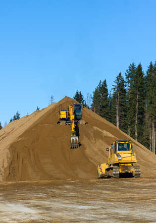 Yellow Excavator and bulldozer at Work in forest Stock Photo