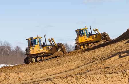 Two bulldozer at Work in forest Stock Photo