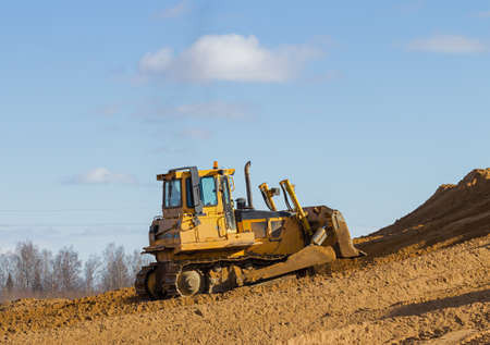 Yellow bulldozer at Work in forest Stock Photo - 18880473
