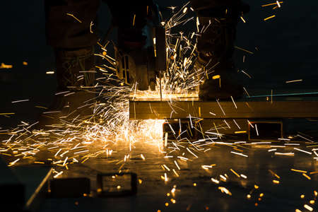 sharpening and cutting of iron by abrasive disk machine Stock Photo