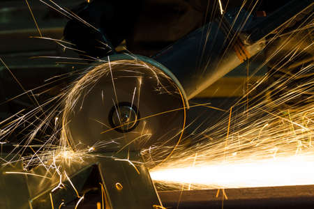 sharpening and cutting of iron by abrasive disk machine Stock Photo - 22308639