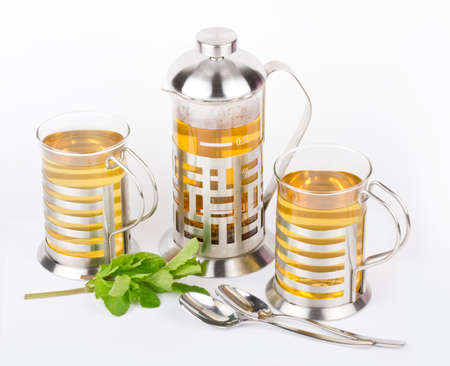 Teaapot and cups from glass with mint photo