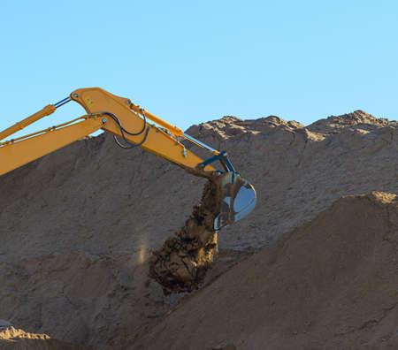 Yellow Excavator at Work photo