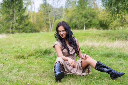 Elegant attractive woman on a meadow