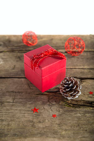 Christmas present on wooden background photo