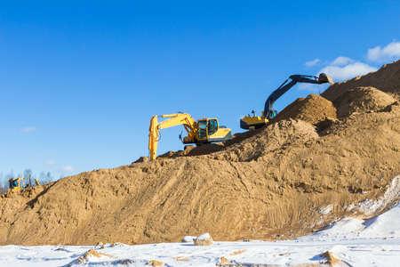 Yellow excavator at work Фото со стока - 23997147