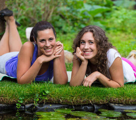 Two beautiful young brunet woman outdoors photo