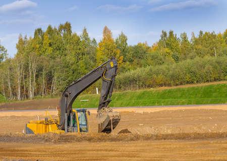 Yellow Construction Excavator at Work