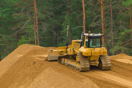 Yellow buldozer at work