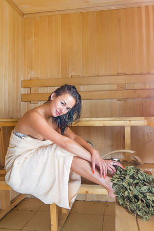Young pretty woman in sauna photo