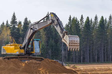 Yellow Construction Excavator at Work photo