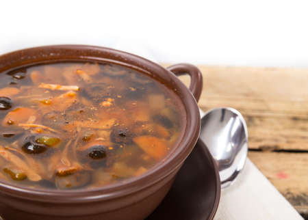 Traditional Russian meat soup with salty cucumbers Stock Photo