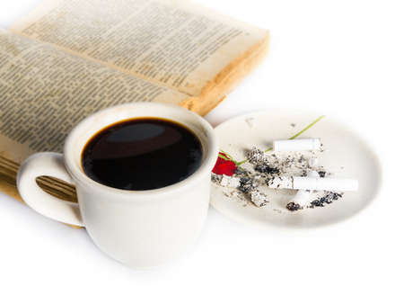 Coffee, book and cigarettes on white photo