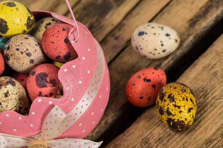 Easter eggs composition on wooden background photo