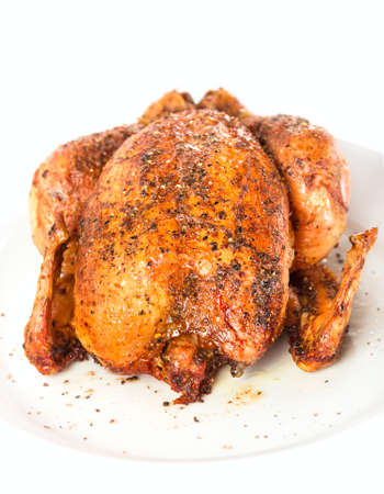 Roasted chicken hot on a plate white photo