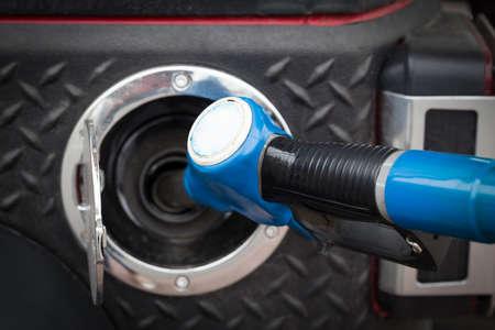 Buying petrol on gas station close up photo
