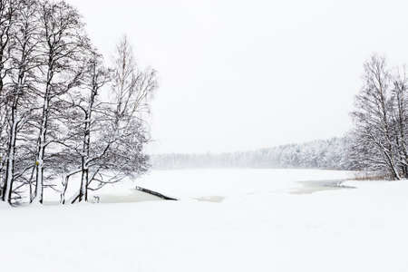 wintery day: winter lake in ice and snow in russia Stock Photo