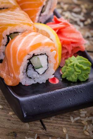 philadelphia roll: Salmon sushi rolls on a wooden