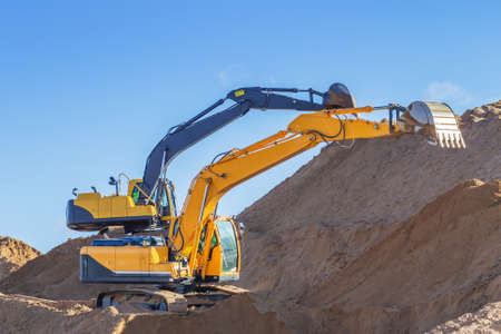 Yellow Excavator and bulldozer at Work in forest photo